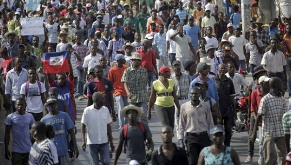 Protesters march during a demonstration against the electoral process in Port-au-Prince, Haiti.