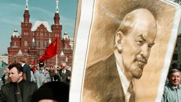 Demonstrator holds picture of Vladimir Lenin, founder of the Union of Soviet Socialist Republics