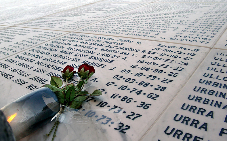 Flowers are left behind on the memorial of disappeared persons at a general cemetery in Santiago, Chile.