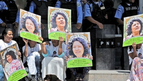 Activists demand justice for Berta Caceres in front of a police line in Tegucigalpa, Honduras, March 17, 2016.
