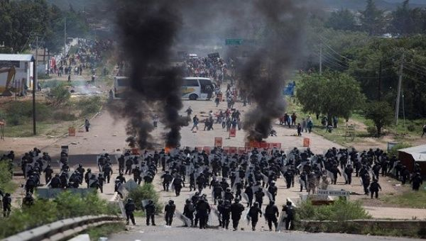 Policemen clashing with dissident teachers in Oaxaca, Mexico, June 19, 2016.