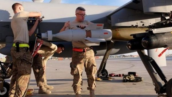A U.S. Air Force ground crew secures weapons to an MQ-9 Reaper drone after it returned from a mission, Kandahar Airfield, Afghanistan, March 9, 2016.