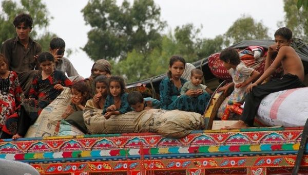 Children sit in the back of a truck as they prepare to return to Afghanistan, at a U.N. refugee repatriation center in Peshawar, Pakistan August 2, 2016.