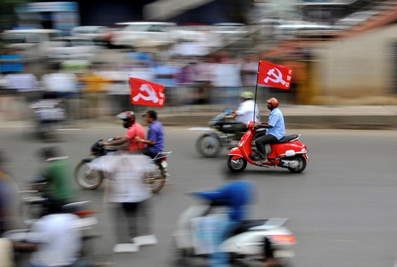 Workers from different trade unions ride motorcycles during a protest rally, as part of a nationwide strike, in Bengaluru, India September 2, 2016.