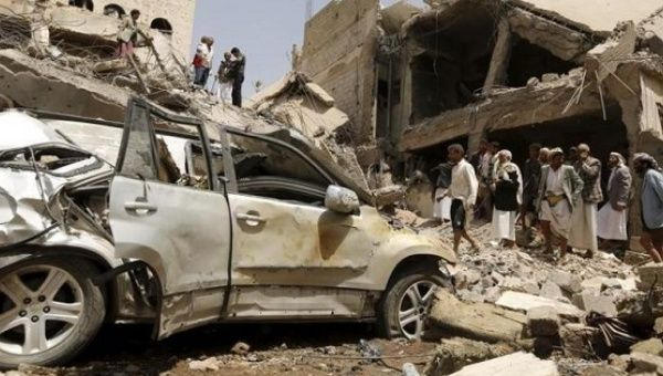 People gather at the site of a Saudi-led air strike in Yemen