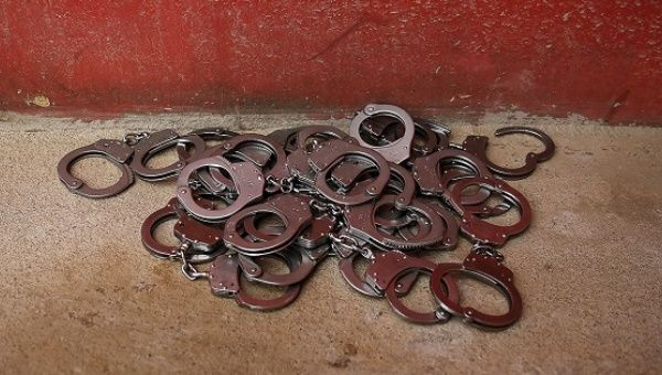 Handcuffs lie on the floor at the entrance of Acuda