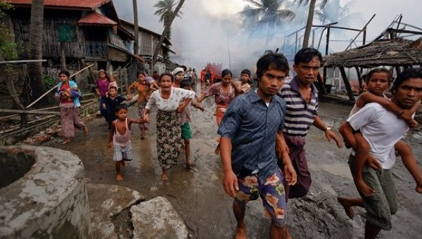 More than 30,000 people have fled to Bangladesh, escaping the violence which has renewed international criticism that Aung San Suu Kyi