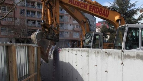 Bulldozers demolish a wall following weeks of tensions between Kosovo and Serbia, in the ethnically divided town of Mitrovica, Kosovo, Feb. 5, 2017.