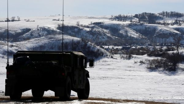 A North Dakota National Guard vehicle idles on the outskirts of the Dakota Access pipeline protest camp near Cannon Ball, North Dakota, U.S.