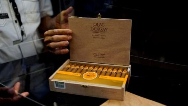 People open a box of cigars on display at the 19th Habanos Festival in Havana, Cuba, Feb. 27, 2017.