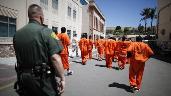 Inmates are escorted by a guard through San Quentin state prison in California, June 8, 2012.