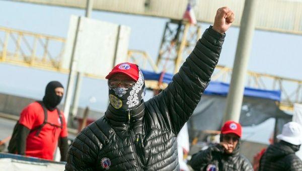 Miners protest at the entrance of Puerto Coloso, in La Escondida mine, in Antofagasta, Chile, March 2017.