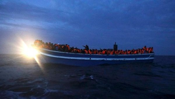 Refugees are seen on board a drifting overcrowded wooden boat, during a rescue operation by the Spanish NGO Proactiva Open Arms, March 29, 2017.