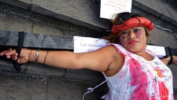 "Norma ""Pirulina"" Galicia takes part in a protest on the International Day for the Elimination of Violence Against Women in Guatemala City, Nov. 25, 2013."