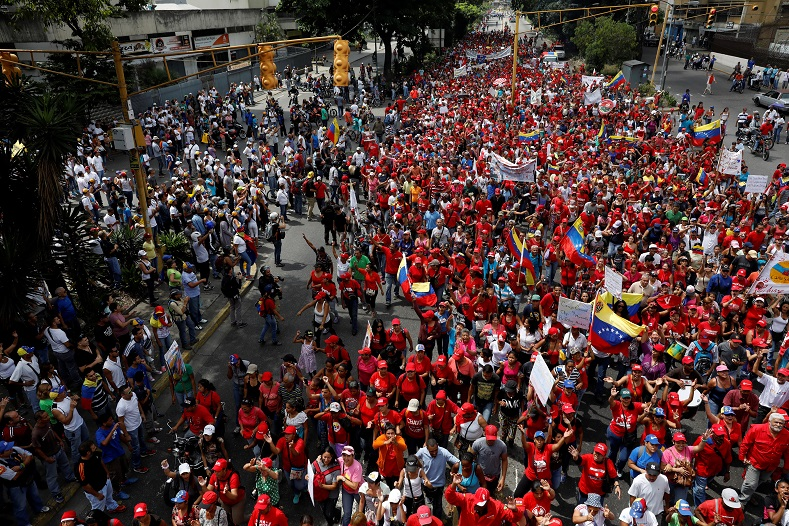 Supporters (in red) of Venezuela