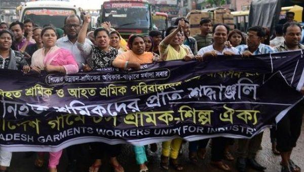 Bangladeshi activists mark the fourth anniversary of the Rana Plaza building collapse.