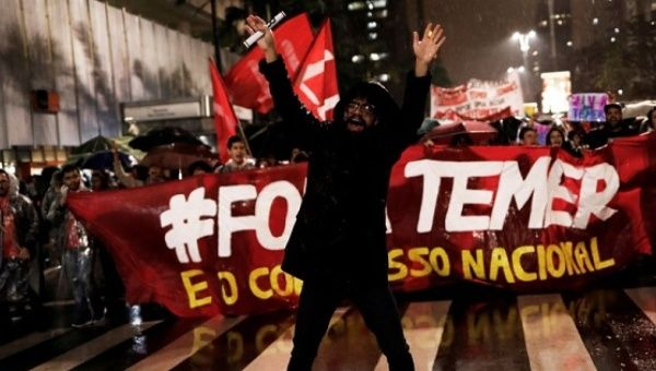 Demonstrators take part in a protest against Brazil
