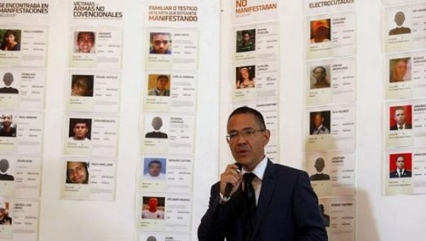 Ernesto Villegas reviews deaths during violent right-wing protests at a press conference in Caracas on May 22, 2017.