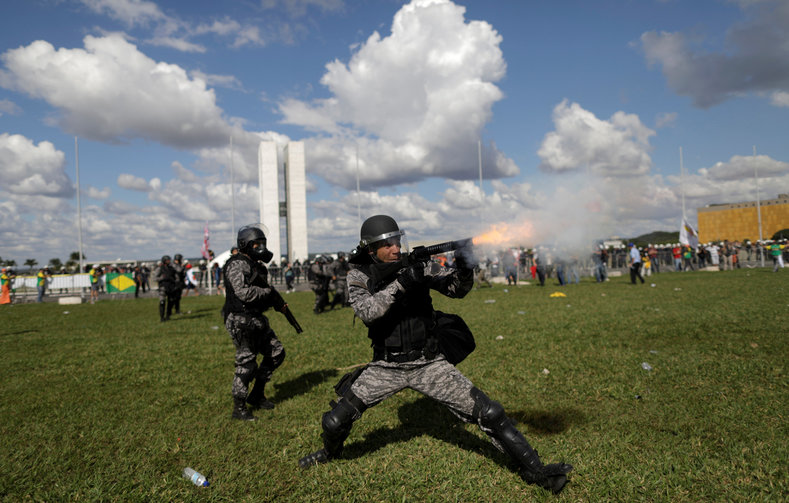 Riot police set up cordons around the modernistic congress building where lawmakers met to discuss a post-Temer transition should the president resign or be ousted by one of Brazil
