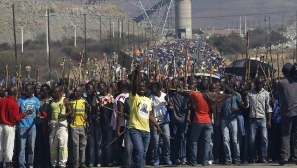Mineworkers take part in a march at Lonmin