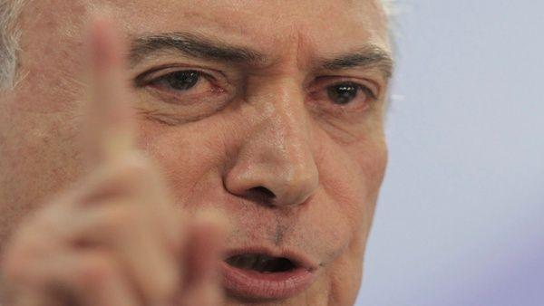 """""""Brasil no paró y no parará, pese a la crisis política por la cual, reconozco, estamos pasando"""", dijo Temer."""