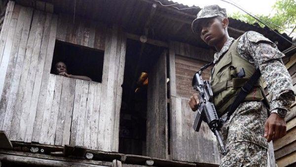 A Colombian marine patrols a neighborhood in Buenaventura.