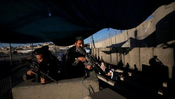Palestinians enter the Israeli Qalandia checkpoint to attend Friday prayer in Jerusalem