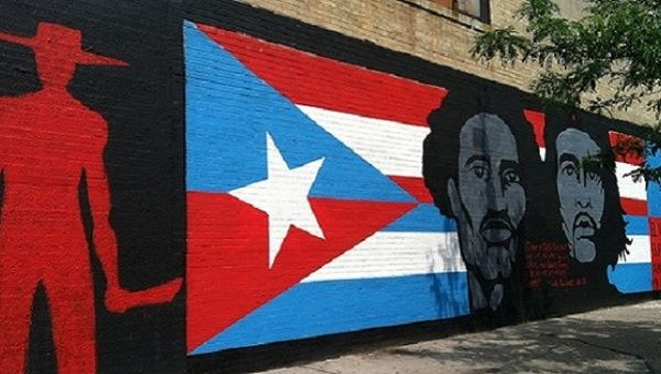 "Che Guevara and Don Pedro Albizu Campos are shown along with the Cuban and Puerto Rican flags in this Spanish Harlem mural titled, ""Dos Alas,"" or ""Two Wings."""