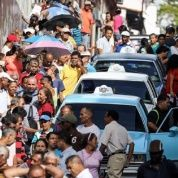 Venezuelans flock to the streets to take part in the dry run vote for the National Constituent Assembly.