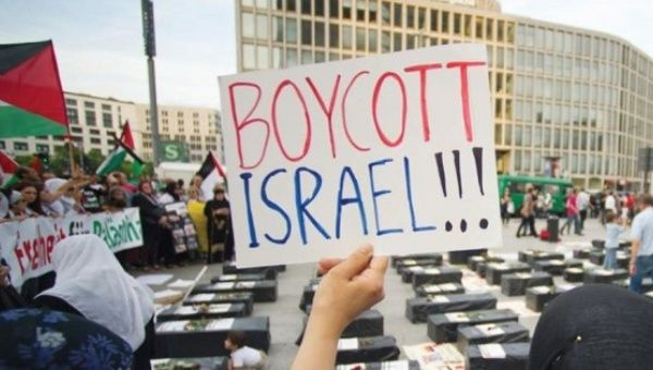 A woman holds a sign during during a rally in support of Palestinian national liberation in Berlin.