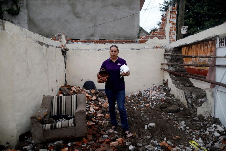 Now living with relatives, this woman and many others hope their destroyed homes will eventually be rebuilt.