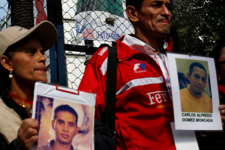 """""""Migrants are international workers,"""" the protesters chant holding portraits of their missing children."""