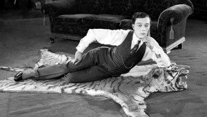 1924: American comedian Buster Keaton (1895-1966) lying on a tigerskin rug in his latest film 'The Navigator'.