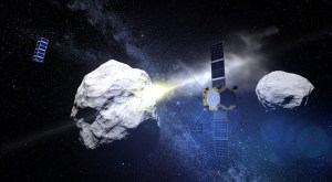 An illustration of ESA's AIM spacecraft, accompanied by two cubesats, observing the collision of NASA's DART spacecraft with a near Earth asteroid. Credit: ESA