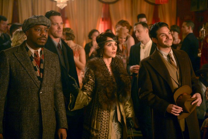 "TIMELESS -- ""The Lost Generation"" Episode 113 -- Pictured: (l-r) Malcolm Barrett as Rufus Carlin, Abigail Spencer as Lucy Preston, Brandon Barash as Hemingway -- (Photo by: Sergei Bachlakov/NBC)"