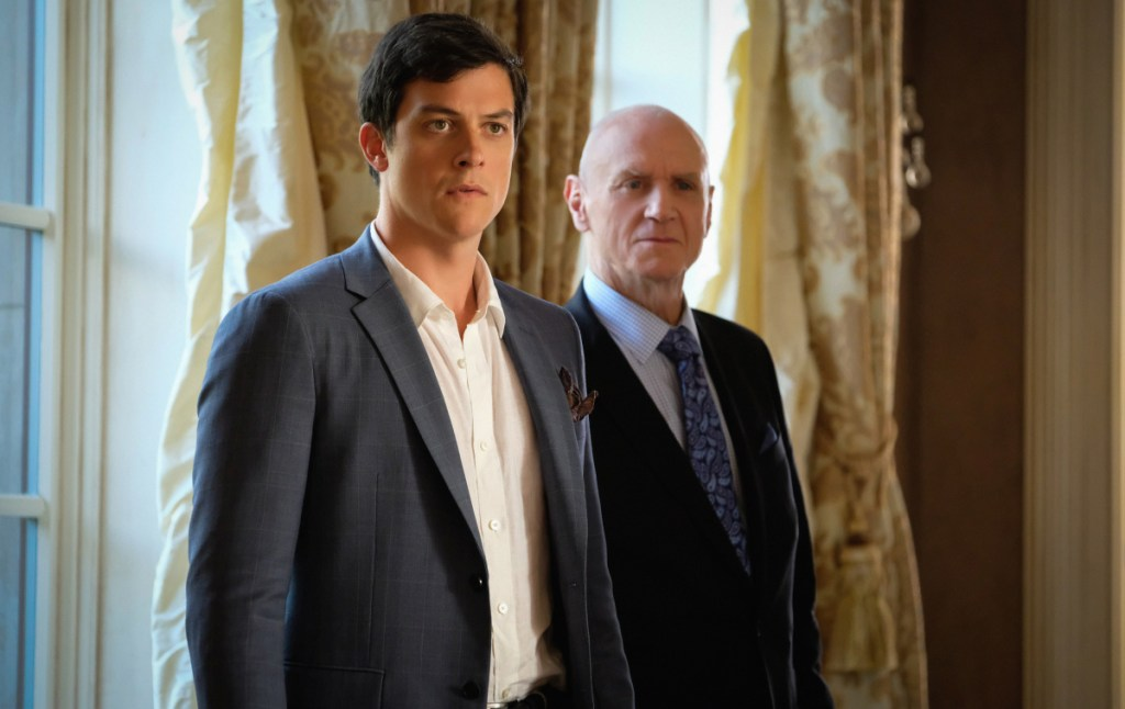 "Dynasty -- ""Pilot"" -- Image Number: DYN101e_1036.jpg -- Pictured (L-R): James Mackay as Steven and Alan Dale as Anders -- Photo: Mark Hill/The CW -- © 2017 The CW Network, LLC. All Rights Reserved."