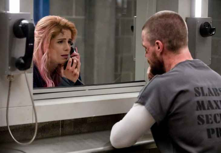Arrow Season 7 Episode 1 - Emily Bett Rickards as Felicity Smoak and Stephen Amell as Oliver Queen/Green Arrow