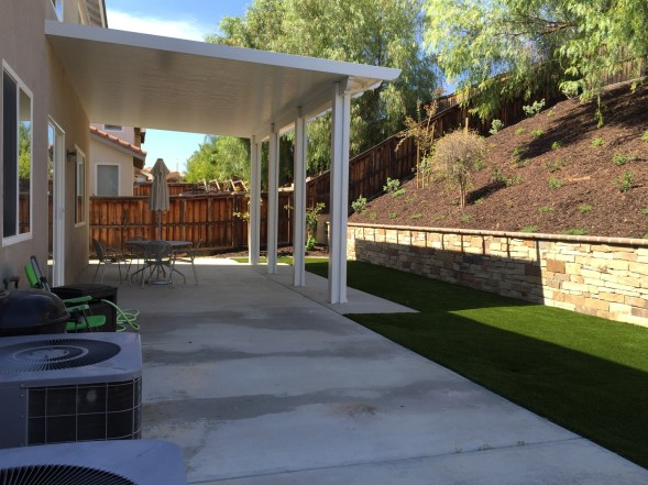 Artificial turf, stone faced wall and patio cover in Temecula McCabe's Landscape Construction
