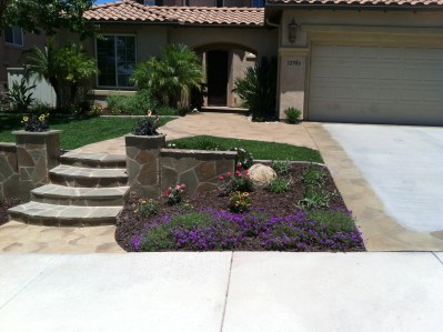 Flagstone steps with pilasters and colorful plants in Temecula McCabe's Landscape Construction