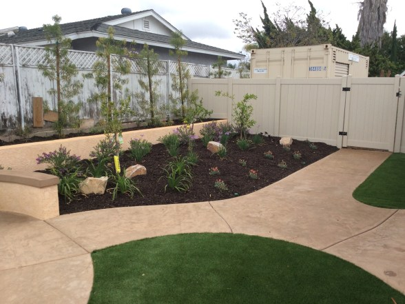 Concrete pathways and artificial turf in Oceanside McCabe's Landscape Construction