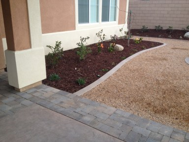 Concrete with paver border McCabe's Landscape Construction
