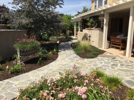 Flagstone pathways in cottage garden with patio cover in Temecula McCabe's Landscape Construction