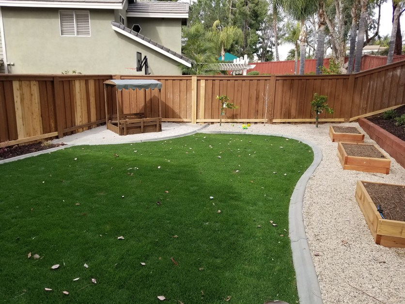 Farm style back yard with planter boxes