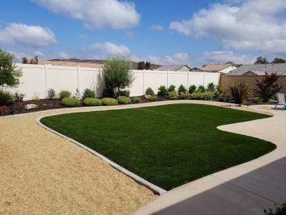 Artificial turf, gravel, concrete, plantings