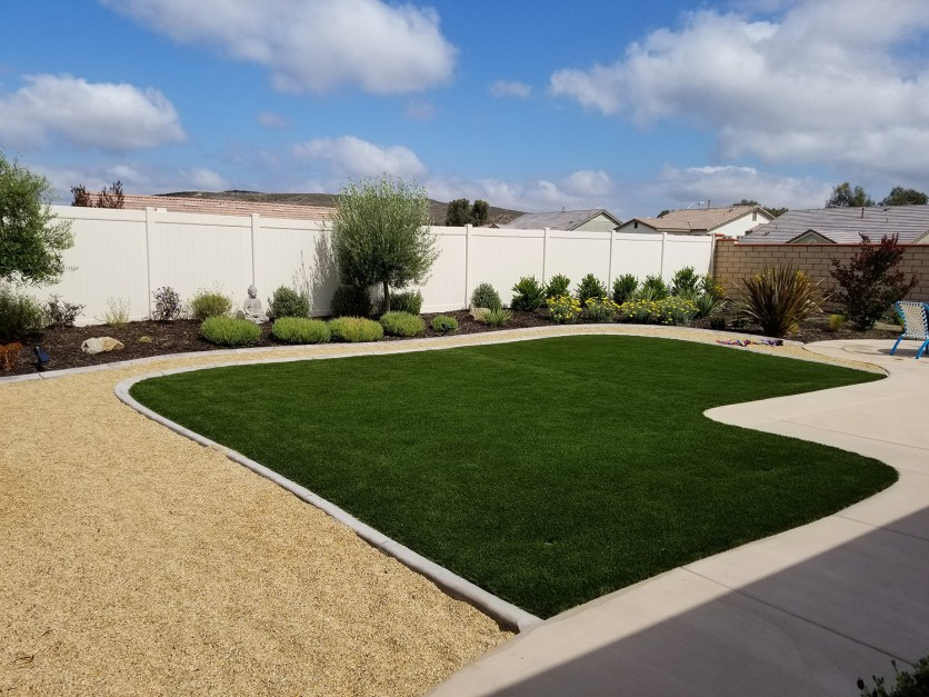 Artificial turf, gravel, concrete, plantings
