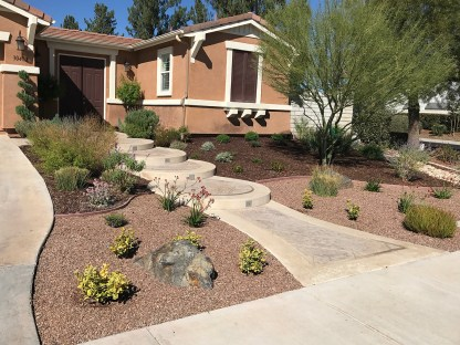 Front yard with gravel and drought tolerant plants
