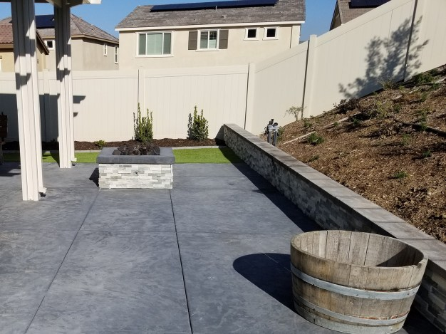 Concrete, fire pit and patio cover