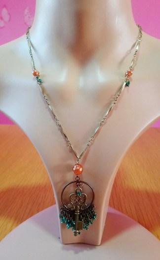 Key and green bead pendant