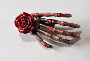 Red and gold shimmer rose skeleton hand hair clip