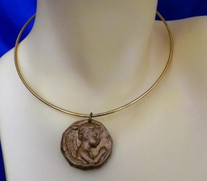 Gold angel child praying cameo and hoop necklace